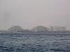 Эйлат. Зимний сезон. Вид на прибрежные отели сквозь дымку тумана